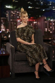 January Jones paired black ankle-strap pumps by Stella Luna with a leopard-print dress for her visit to 'Kimmel.'