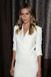 Renee Bargh looks chic with her wavy, middle-parted locks flowing over her shoulders