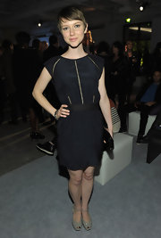 Valorie is oh so sweet in this little black dress with tiny line cutouts.