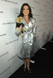 Lisa rocks a metallic trench with her little precious pooch in hand!