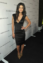 Jessica wears a sleek little black dress to the In Add Minus Flagship launch.