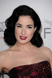 Dita Von Teese always looks perfectly pulled together. She showed off her retro style while attending the Black Swan event. Her raven black waves were a perfect match to her deep red lips.