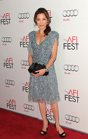 Michelle Yeoh topped off her pretty embellished cocktail frock with classic black peep-toe pumps.