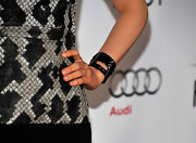 Bella Heathcote looked edgy  wearing a metal cutout cuff to match her snakeskin print dress at a movie premiere.