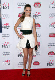 For her footwear, Hilary Swank chose modern black peep-toe heels by Christian Louboutin.