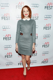 For a pop of color, Jena Malone styled her frock with red pumps.