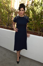 Sarah Silverman looks polished in her navy midi dress with floral appliques on the shoulders