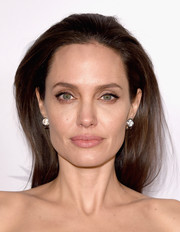 Angelina Jolie opted for a simple straight, partless hairstyle when she attended the AFI Fest opening night premiere of 'By the Sea.'