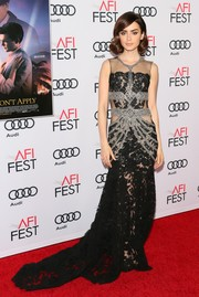 Lily Collins exuded Old Hollywood glamour wearing this gorgeous black Reem Acra gown, in black lace with silver trim, at the AFI Fest premiere of 'Rules Don't Apply.'