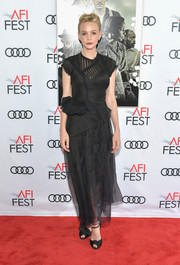 Carey Mulligan coordinated her dress with a pair of black knot-detail peep-toes.