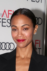 Zoe Saldana opted for a fuss-free ponytail when she attended the AFI FEST screening of 'Hostiles.'