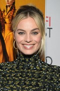 Margot Robbie completed her look with a pair of gold hoops.