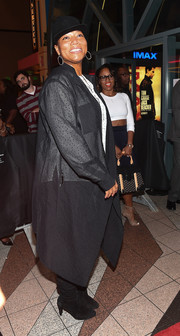 Queen Latifah attended the Atlanta screening of 'Almost Christmas' wearing a sheer black duster.
