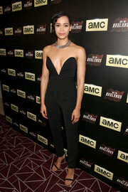 Madeleine Mantock brought plenty of allure to the 'Into the Badlands' premiere with this strapless black jumpsuit boasting a plunging sweetheart neckline.