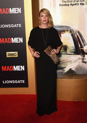Katie Aselton styled her simple gown with an animal-print clutch.