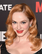 Christina Hendricks added bold color with a pop of red on her lips.