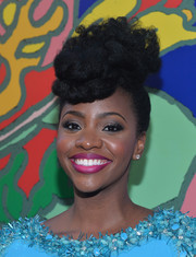 Teyonah Parris attended the 'Mad Men' season 7 premiere wearing her hair piled high in a funky pompadour.