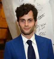 Penn Badgley roughed up his dapper look with a messy head of curls.