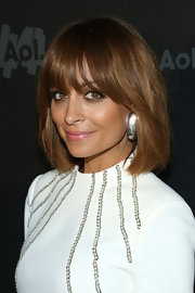 Nicole Richie chose a pale pink lip shade to brighten up her golden complexion.