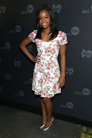 Gabrielle Douglas kept her look fun and flirty with a rose bud-print dress.