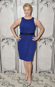 Anna Gunn visited AOL Build wearing a sleeveless blue sheath dress with a crossover skirt.