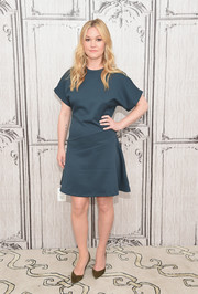 Julia Stiles paired her dress with olive-green suede pumps.