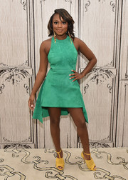 Naturi Naughton mixed loud colors, pairing her green dress with fringed yellow T-strap peep-toes.