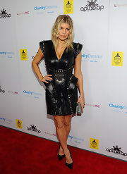 Fergie wore a studded leather dress for the Charity Dreams party.