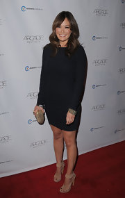 This tight fit little black dress was simple and flattering on Lindsay Price.