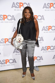 Star Jones added plenty of shine with a pair of silver print pants.