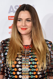 Drew Barrymore was hippie-chic at the Bergh Ball wearing this ultra-long center-parted ombre hairstyle.