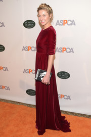 Jessica Hart paired an Olympia Le-Tan book clutch with a red velvet gown for the Bergh Ball.