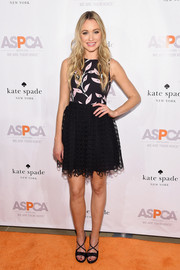 Katrina Bowden matched her dress with a pair of bow-adorned, crisscross-strap sandals.