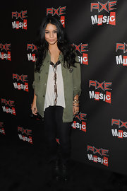 Vanessa Hudgens wore black skinny jeans with a pair of combat boots.