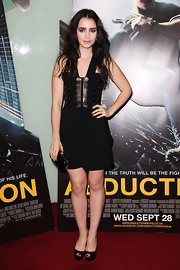 At the 'Abduction' premiere in London, Lily Collins paried her black dress with classic black peep-toe pumps.