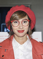 Jackie Cruz matched her wool beret to her eyeglasses, lipstick, and jacket. Cool!
