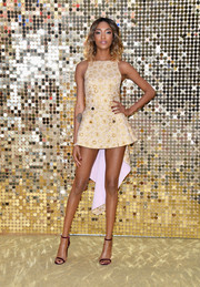 Jourdan Dunn highlighted her long, slim pins in a tiny gold jacquard mini by Antonio Berardi during the world premiere of 'Absolutely Fabulous.'