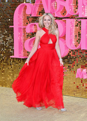 Kylie Minogue made a grand entrance in a bright red cutout gown by Roberto Cavalli at the world premiere of 'Absolutely Fabulous: The Movie.'