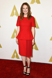 Julianne attended the Academy Awards Nominee Luncheon looking ravishing in a red dress with peplum and sash detail.