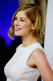 Rosamund Pike wore her hair flicked out slightly at the Academy Awards Nominee Luncheon.