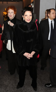 Liza Minnelli was seen at a ribbon cutting event wearing a velvet blazer on top of a turtleneck sweater.