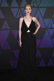 Elizabeth Debicki went majorly goth in a slouchy black cutout gown by Giambattista Valli Couture paired with dark lipstick at the 2018 Governors Awards.
