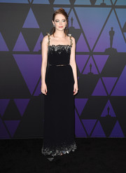 Emma Stone cut a sophisticated figure in a black Louis Vuitton column dress with a beaded neckline and hem at the 2018 Governors Awards.