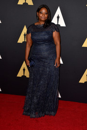 Octavia Spencer chose a blue Christian Louboutin satin clutch to complete her look.