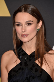Keira Knightley wore a pair of emerald studs for a splash of color to her LBD during the Governors Awards.