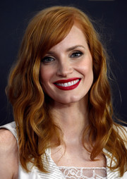 Jessica Chastain's red lips contrasted wonderfully with her burnt orange hair.