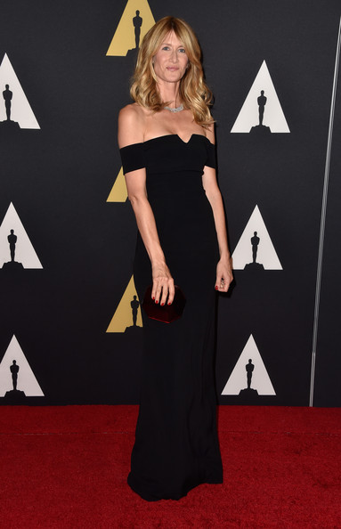 Laura Dern styled her gown with an octagonal clutch by Rauwolf.