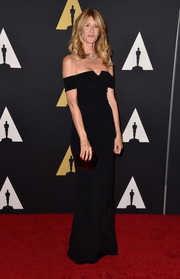 Laura Dern exuded classic elegance in a black off-the-shoulder column dress by Grace MMXIII during the Governors Awards.