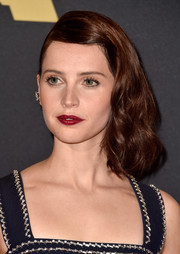 Felicity Jones punctuated her look with a deep-red lip.