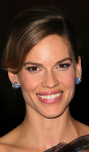 Hilary Swank added a little sparkle to her look by adding a subtle swipe of metallic purple eyeshadow on her lower lid. She kept the rest of her look minimal with soft pink lips and a light application of blush.
